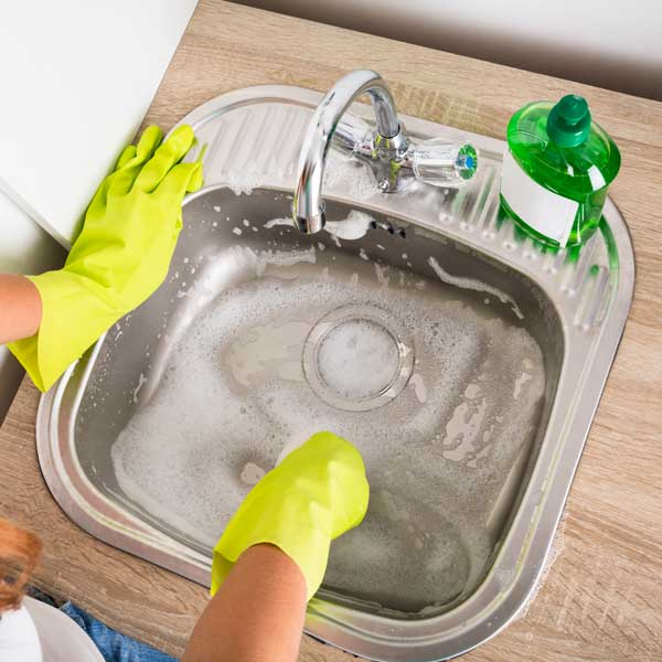 woman scrubbing sink